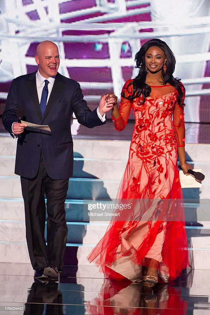 Chet Buchanan (L) and Miss USA 2012 Nana Meriwether host the 2013 Miss USA pageant preliminary competition at PH Live at Planet Hollywood Resort & Casino on June 12, 2013 in Las Vegas, Nevada.