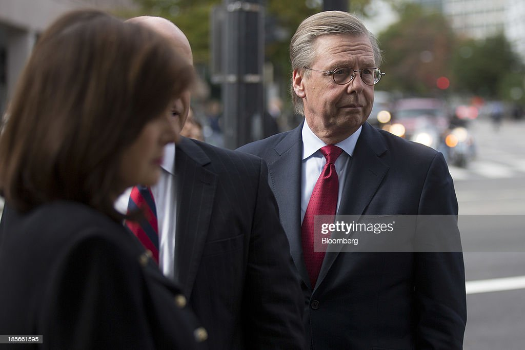 Chet Burrell, chief executive officer of CareFirst BlueCross BlueShield, waits to go through security near the White House in Washington, D.C., U.S., on Wednesday, Oct. 23, 2013. Health insurance executives including WellPoint Inc. Chief Executive Officer Joseph Swedish will meet with top White House officials today as President Barack Obama seeks to contain political damage over the rollout of online enrollment for his health-care expansion. Photographer: Andrew Harrer/Bloomberg via Getty Images
