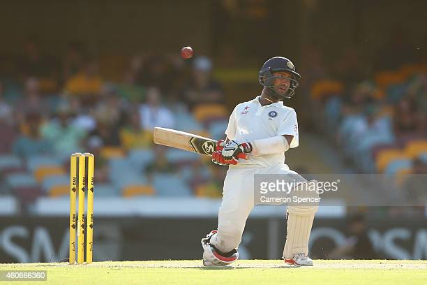 Cheteshwar Pujara of India avoids a bouncer during day three of the 2nd Test match between Australia and India at The Gabba on December 19 2014 in...