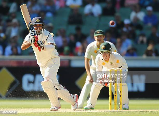 Cheteshwar Pujara of India bats as wicketkeeper Brad Haddin of Australia looks on during day two of the Third Test match between Australia and India...