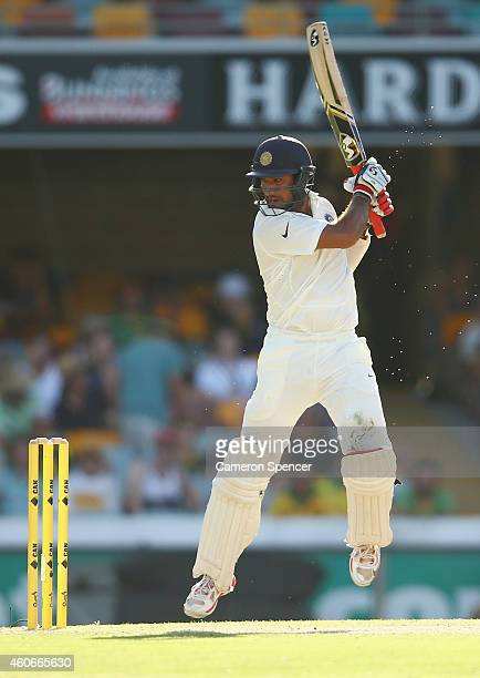 Cheteshwar Pujara of India bats during day three of the 2nd Test match between Australia and India at The Gabba on December 19 2014 in Brisbane...