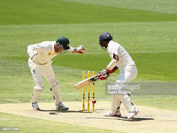 Cheteshwar Pujara of India is bowled by Nathan Lyon of Australia during day three of the First Test match between Australia and India at Adelaide...