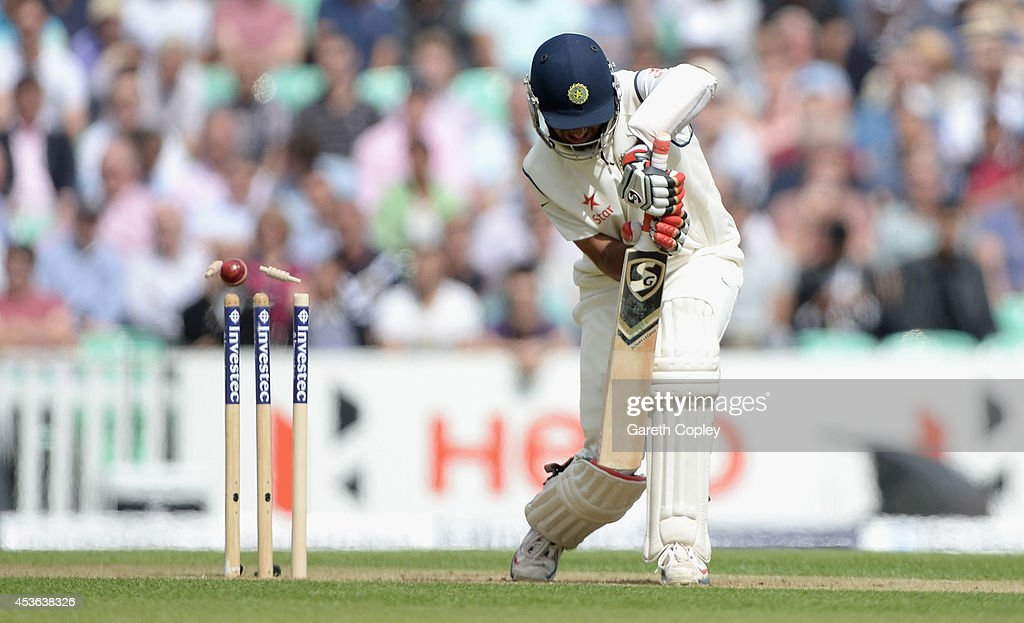 <a gi-track='captionPersonalityLinkClicked' href=/galleries/search?phrase=Cheteshwar+Pujara&family=editorial&specificpeople=815522 ng-click='$event.stopPropagation()'>Cheteshwar Pujara</a> of India is bowled by Stuart Broad of England during day one of 5th Investec Test match between England and India at The Kia Oval on August 15, 2014 in London, England.