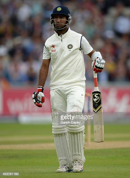 Cheteshwar Pujara of India leaves the field after being dismissed by Stuart Broad of England during day one of 4th Investec Test match between...