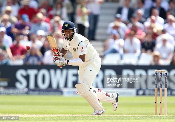 Cheteshwar Pujara of India plays to the midwicket region during day one of the 1st Investec Test between England and India at Trent Bridge on July 9...