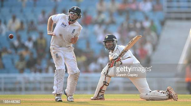 Cheteshwar Pujara of Mumbai A hits past Ian Bell of England during day two of the tour match between Mumbai A and England at The Dr DY Palit Sports...