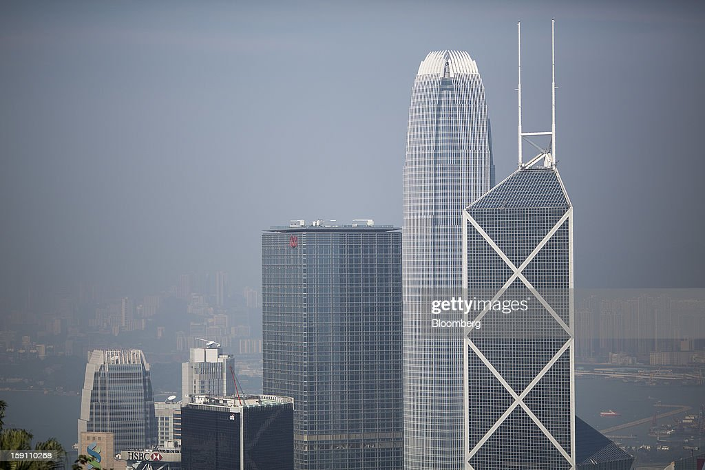 Cheung Kong Center, center, Two International Finance Center (IFC), second right, and Bank of China Tower, right, stand in the central business district of Hong Kong, China, on Saturday, Jan. 5, 2013. Hong Kong topped the ranks as the most expensive office market by total occupancy cost, according to a report by CBRE Research released on Jan. 7. Photographer: Jerome Favre/Bloomberg via Getty Images