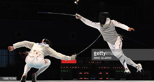Cheung Siu Lun of Hong Kong in action against Choi Byung Chui of South Korea in the fianl of the Men's Individual Foil fencing at the 16th Asian...