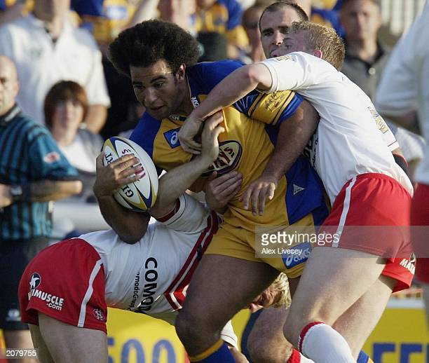 Chev Walker of Leeds Rhinos is stopped by the St Helens defence during the Tetley's Super League match between Leeds Rhinos and St Helens on June 13...