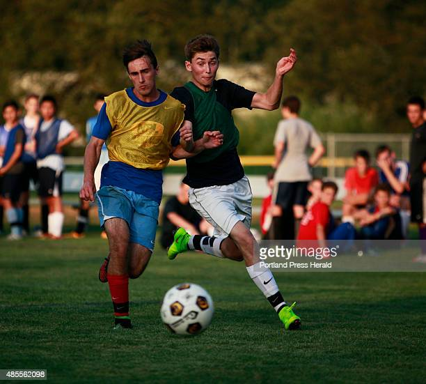 Cheverus high school boys soccer Juniors Will Peterson left and Nick Hase vie for the ball