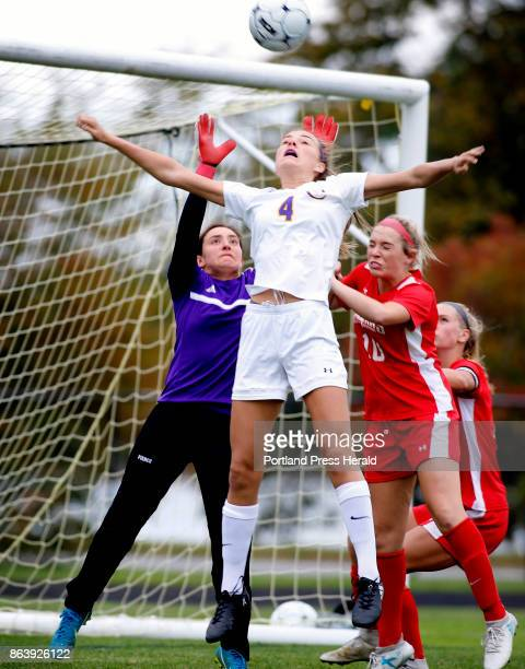 Cheverus vs Sanford girls soccer Kayla Pierce left Julia Allen of Sanford defend the goal as Zoe Mazur of Cheverus tries to get her head on a corner...