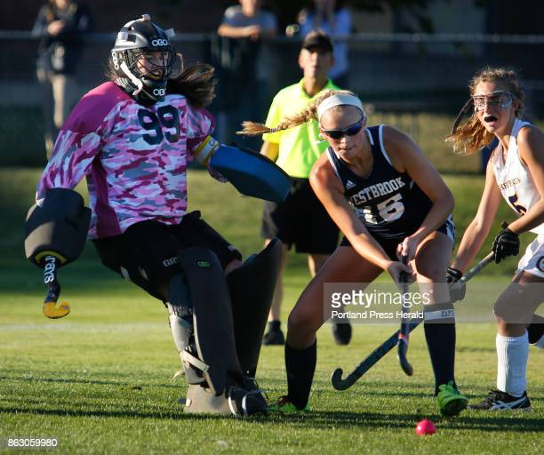Cheverus vs Westbrook field hockey on Wednesday October 18 2017 Cheverus senior goalie Kat Kane makes a save as Avery Tucker of Westbrook tries to...