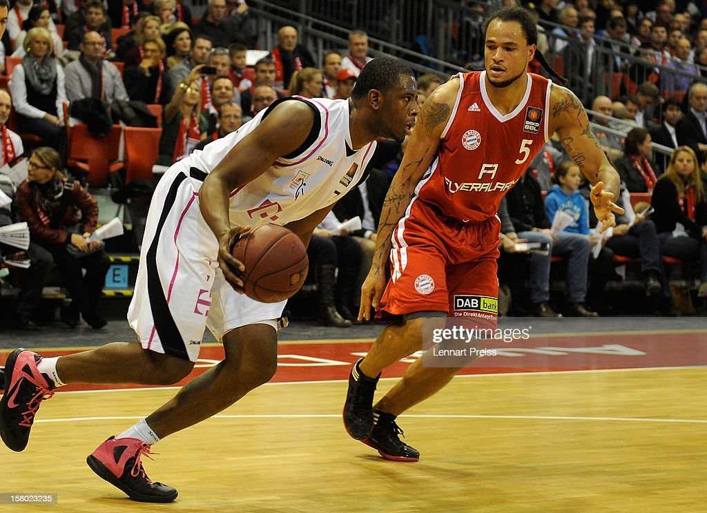 Chevon Troutman (R) of Muenchen challenges Patrick Ewing Jr. of Bonn during the Beko Basketball match between FC Bayern Muenchen and Telekom Baskets Bonn at Audi-Dome on December 9, 2012 in Munich, Germany.