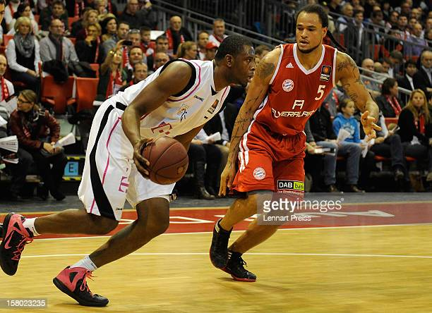 Chevon Troutman of Muenchen challenges Patrick Ewing Jr of Bonn during the Beko Basketball match between FC Bayern Muenchen and Telekom Baskets Bonn...