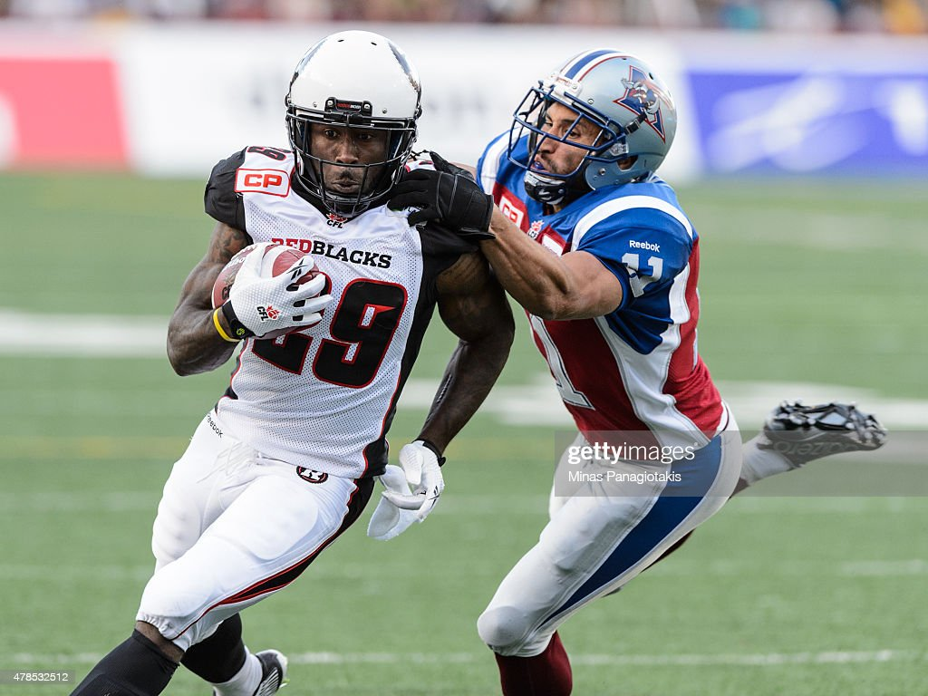 Chevon Walker #29 of the Ottawa Redblacks runs with the ball past Chip Cox #11 of the Montreal Alouettes during the CFL game at Percival Molson Stadium on June 25, 2015 in Montreal, Quebec, Canada.