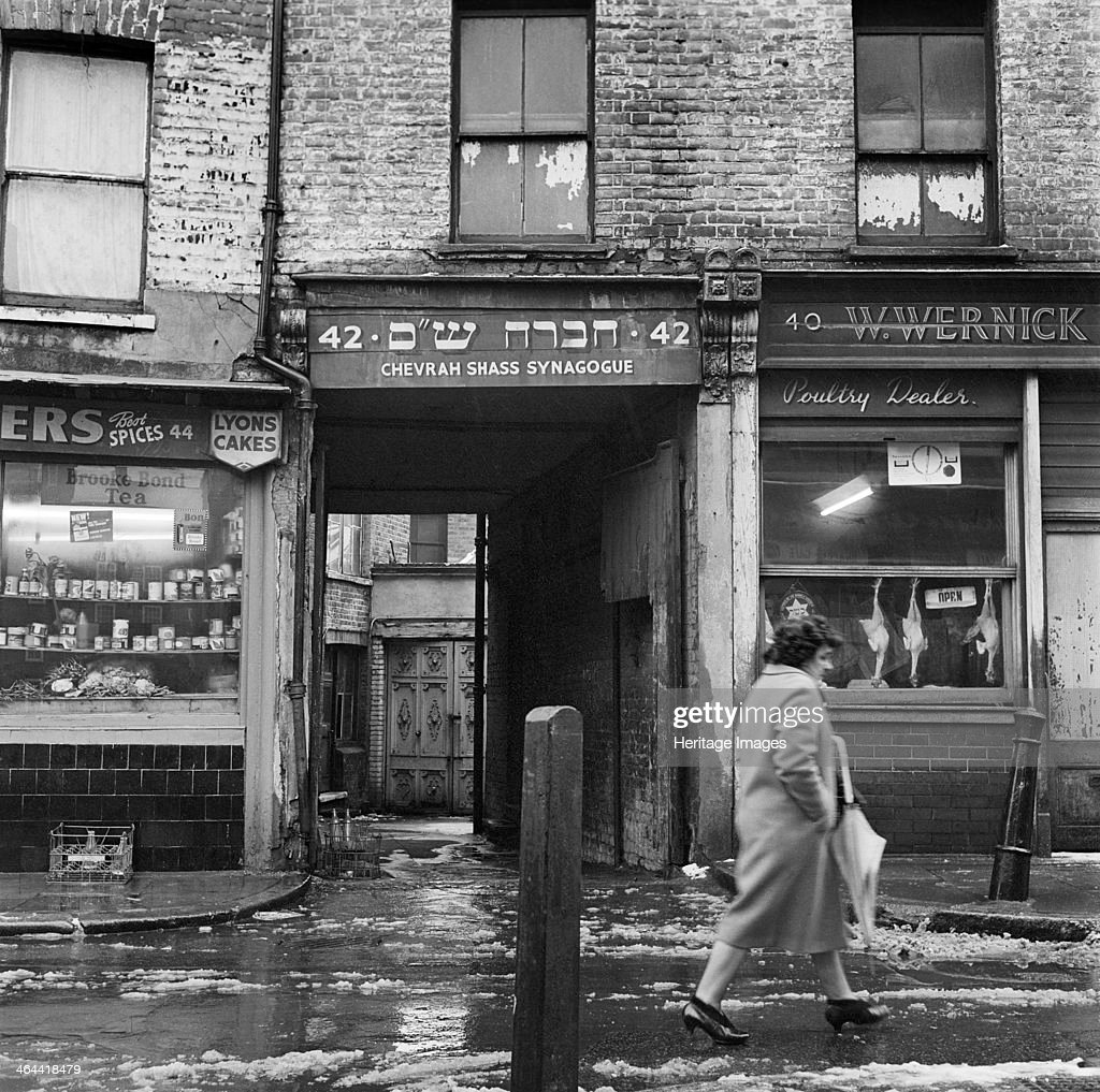 Chevrah Shass Synagogue Whitechapel London 19461959 On a cold day a woman walks past the Chevrah Shass Synagogue which is tucked away down an alley...