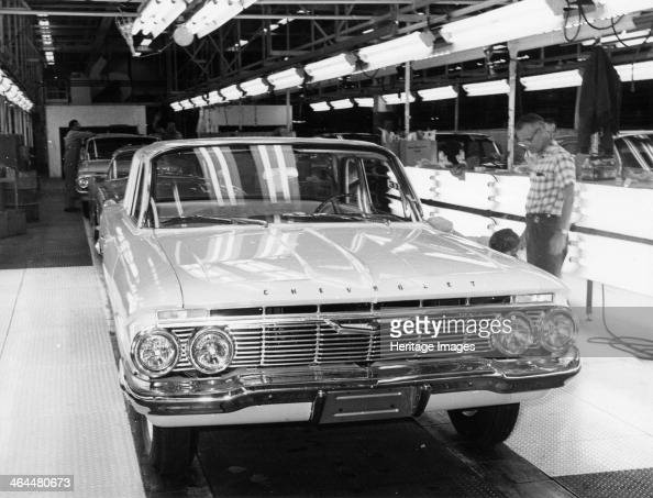 Chevrolet assembly line Two plant workers check the wheels