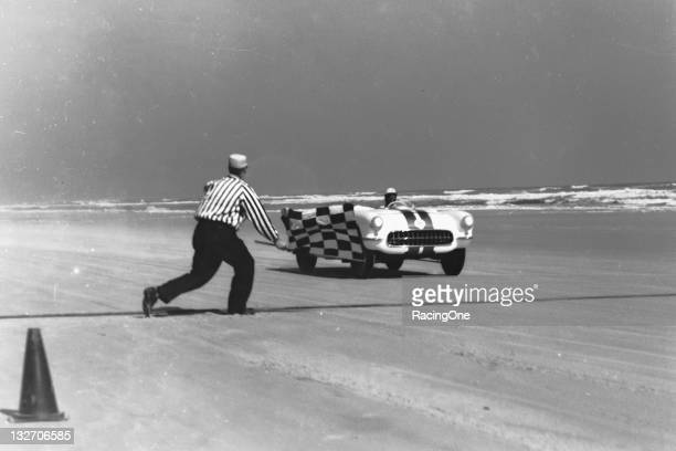 Chevrolet Corvette takes the checkered flag following a speed tial run on the Daytona Beach Road Course