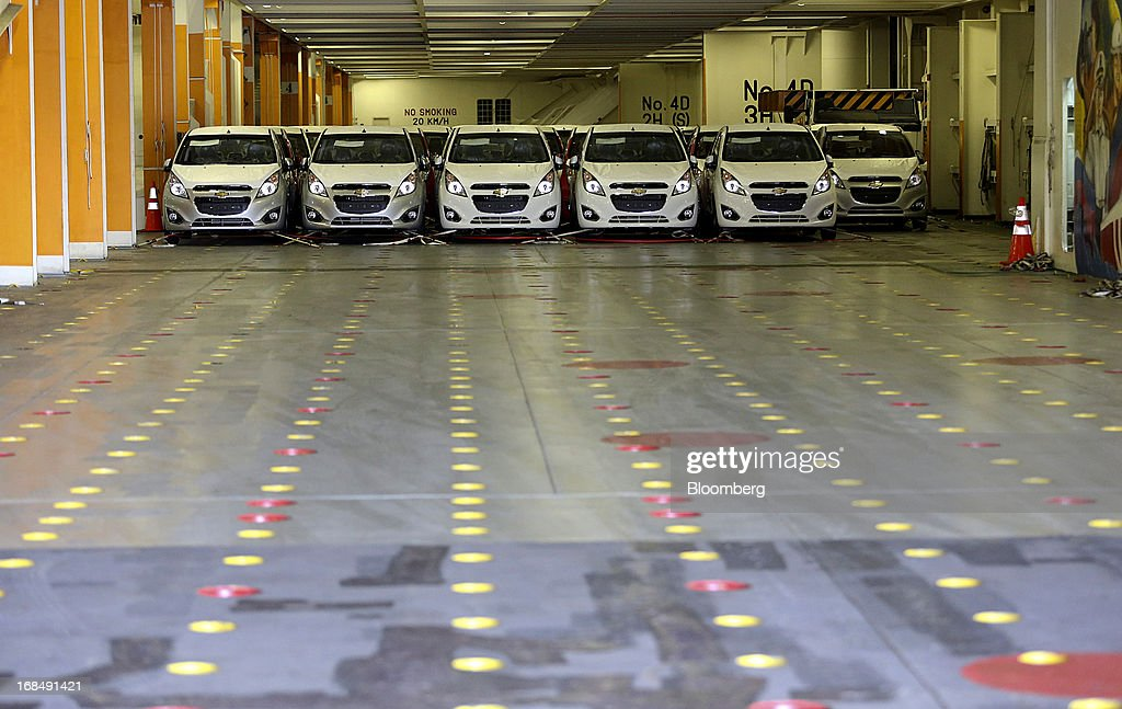 Chevrolet Spark EV automobiles stand aboard the 'Silverstone Express' vehicle carrier at the port of Koper, operated by Luka Koper d.d., in Koper, Slovenia, on Thursday, May 9, 2013. The former Yugoslav nation, mired in its second recession since 2009, will contract this year and next, according to a May 3 report by the European Commission. Photographer: Chris Ratcliffe/Bloomberg via Getty Images