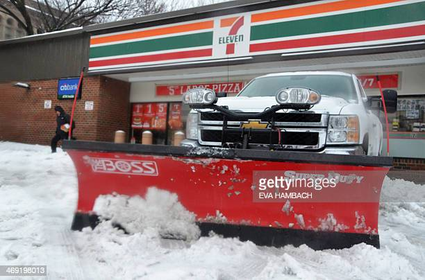 A Chevrolet truck mounted with a Boss SuperDuty snowplow sits in front of a 7 Eleven grocery store in downtown Washington DC early February 13 2014...