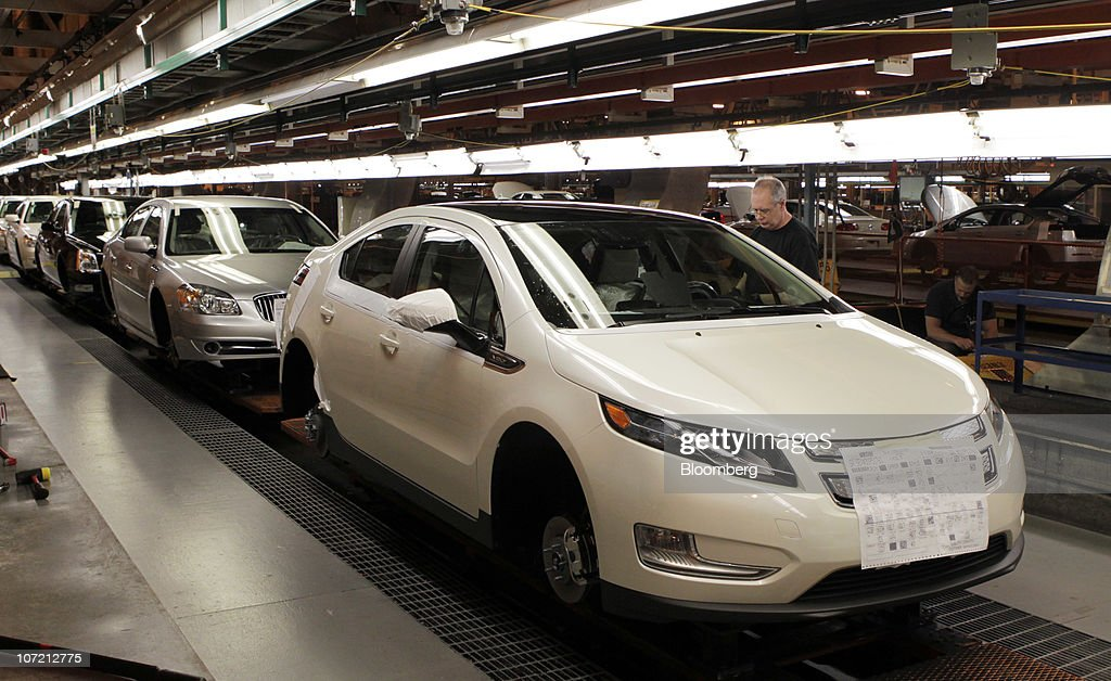 Chevrolet Volt cars move down the production line at General Motors Co.'s Detroit-Hamtramck Assembly plant in Detroit, Michigan, U.S., on Tuesday, Nov. 30, 2010. General Motors Co., the maker of the Chevrolet Volt gasoline-electric car, will hire 1,000 engineers in Michigan to help expand the automakers' lineup of electric-drive vehicles. Photographer: Jeff Kowalsky/Bloomberg via Getty Images