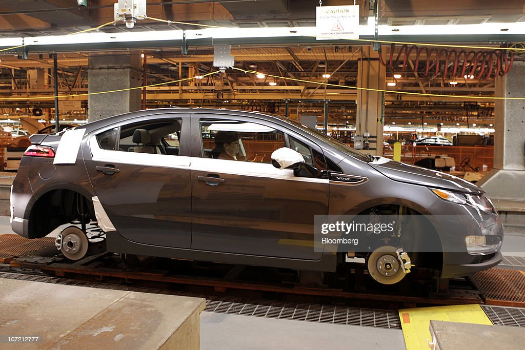 A Chevrolet Volt moves down the production line at General Motors Co.'s Detroit-Hamtramck Assembly plant in Detroit, Michigan, U.S., on Tuesday, Nov. 30, 2010. General Motors Co., the maker of the Chevrolet Volt gasoline-electric car, will hire 1,000 engineers in Michigan to help expand the automakers' lineup of electric-drive vehicles. Photographer: Jeff Kowalsky/Bloomberg via Getty Images