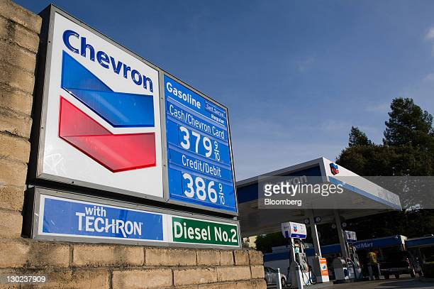 Chevron Corp signage in displayed at a gas station in Berkeley California US on Monday Oct 24 2011 Chevron Corp is expected to announce thirdquarter...