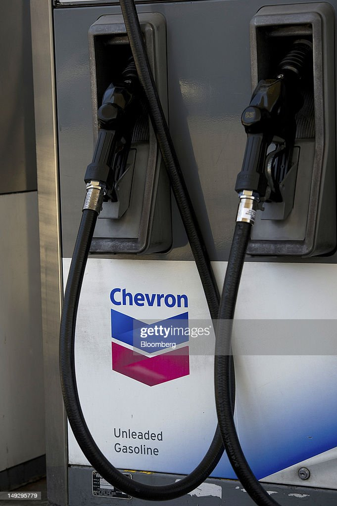 Chevron Corp. signage is displayed at a gasoline station in San Francisco, California, U.S., on Wednesday, July 25, 2012. Chevron is expected to release earnings data on July 27. Photographer: David Paul Morris/Bloomberg via Getty Images
