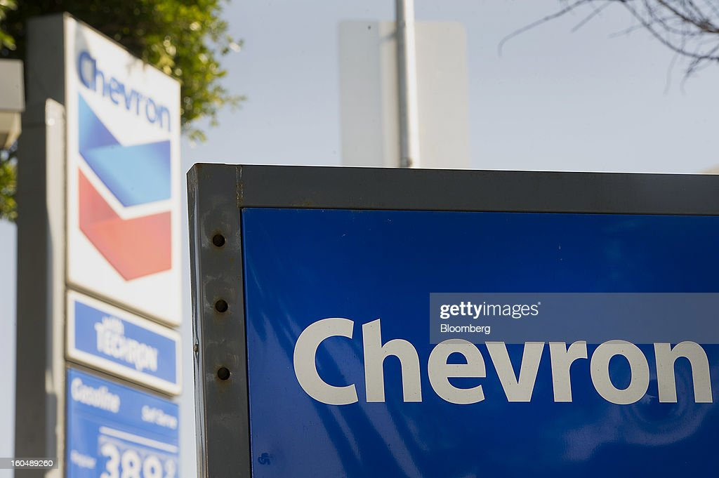 Chevron Corp. signage is displayed at a station in San Francisco, California, U.S., on Friday, Feb. 1, 2013. Chevron Corp., the second-largest U.S. energy company, said fourth-quarter profit increased 41 percent to a record $7.25 billion as it reported stronger refining results and a gain from an Australian natural gas field swap. Photographer: David Paul Morris/Bloomberg via Getty Images