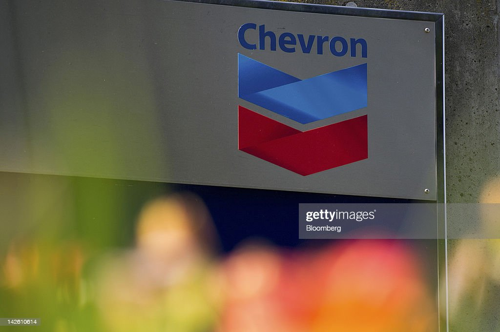 Chevron Corp. signage stands at the entrance to the company's corporate headquarters in Richmond, California, U.S., on Friday, April 6, 2012. Gasoline slid to a four-week low as slower job growth in the U.S. and accelerating inflation in China raised concern that global demand for fuel may shrink. Photographer: David Paul Morris/Bloomberg via Getty Images