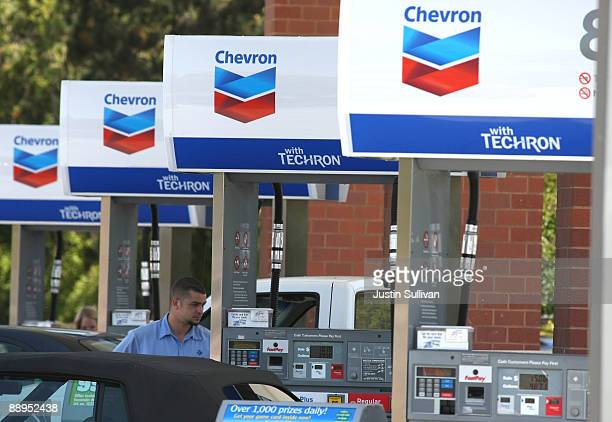 Chevron customer looks on as he pumps gas into his car at a Chevron service station July 9 2009 in Greenbrae California Chevron will report quarterly...