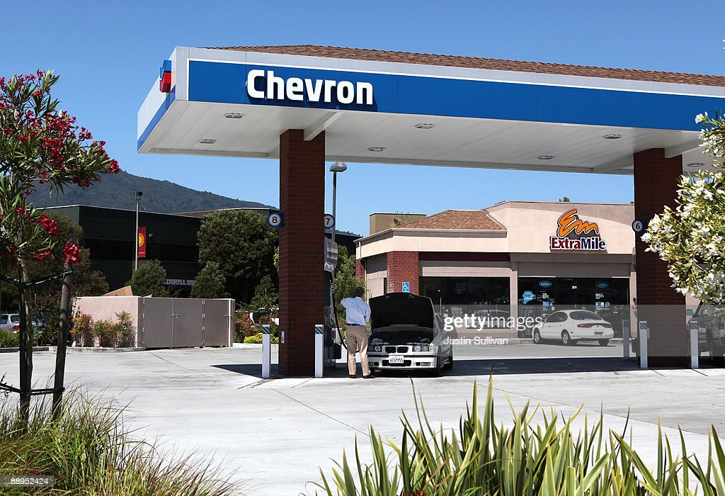 Chevron customer looks under the hood of his car at a Chevron service station July 9 2009 in Greenbrae California Chevron will report quarterly...