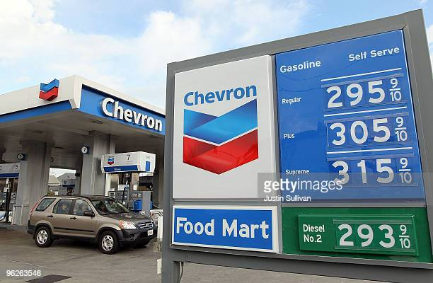 Chevron customers drive out of a Chevron gas station January 29 2010 in Alameda California Chevron reported a 37 percent decline in fourth quarter...
