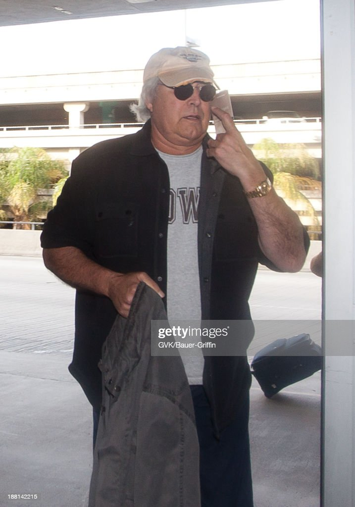 Chevy Chase is seen arriving at LAX airport on November 15, 2013 in Los Angeles, California.