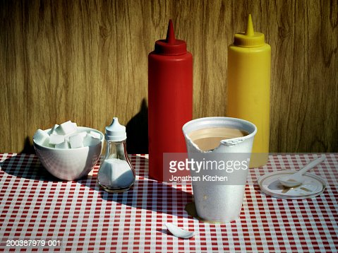 Chewed polystyrene cup by condiments : Stock Photo