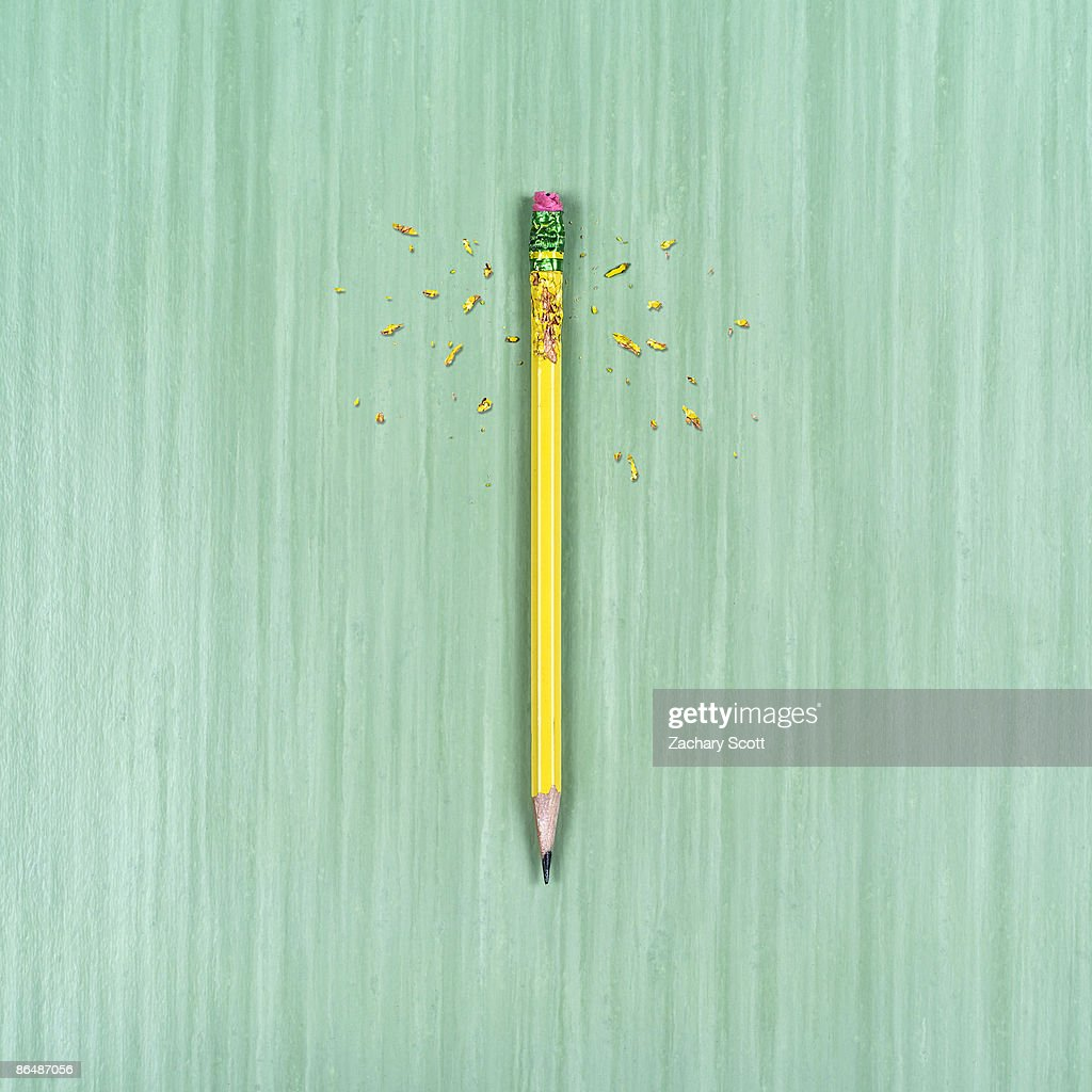 chewed up pencil on table surface : Stock Photo