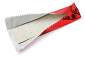 Chewing gum plate wrapped in red foil isolated on white with clipping path