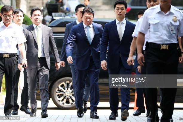 Chey Taewon chairman of SK Holdings Co center arrives at the Seoul Central District Court in Seoul South Korea on Thursday June 22 2017 South Korean...