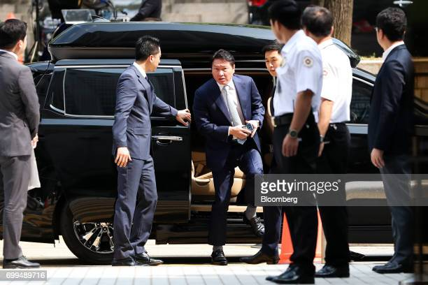Chey Taewon chairman of SK Holdings Co center exits a vehicle as he arrives at the Seoul Central District Court in Seoul South Korea on Thursday June...
