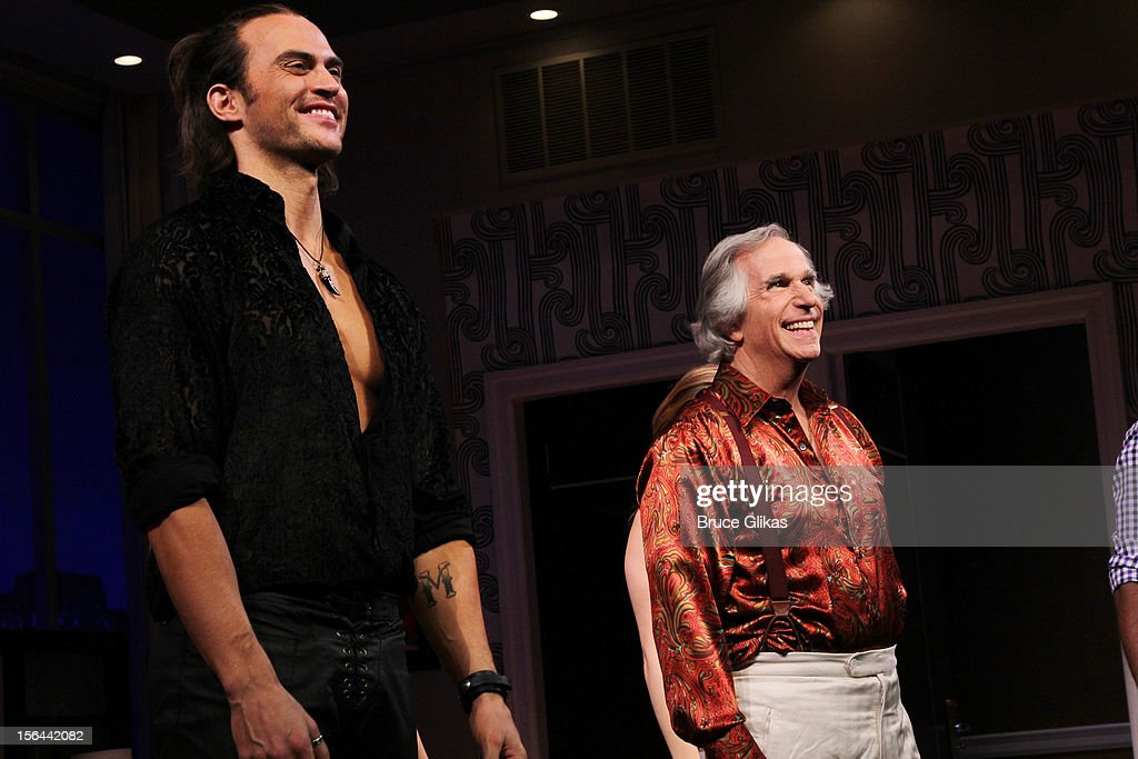<a gi-track='captionPersonalityLinkClicked' href=/galleries/search?phrase=Cheyenne+Jackson&family=editorial&specificpeople=216481 ng-click='$event.stopPropagation()'>Cheyenne Jackson</a> and <a gi-track='captionPersonalityLinkClicked' href=/galleries/search?phrase=Henry+Winkler+-+Actor&family=editorial&specificpeople=206799 ng-click='$event.stopPropagation()'>Henry Winkler</a> take the opening night curtain call for 'The Performers' on Broadway at the Longacre Theatre on November 14, 2012 in New York City.