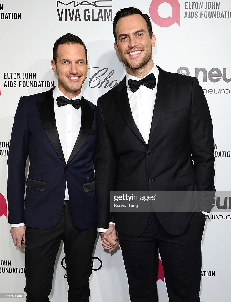 <a gi-track='captionPersonalityLinkClicked' href=/galleries/search?phrase=Cheyenne+Jackson&family=editorial&specificpeople=216481 ng-click='$event.stopPropagation()'>Cheyenne Jackson</a> and <a gi-track='captionPersonalityLinkClicked' href=/galleries/search?phrase=Jason+Landau&family=editorial&specificpeople=12016867 ng-click='$event.stopPropagation()'>Jason Landau</a> arrive for the 22nd Annual Elton John AIDS Foundation's Oscar Viewing Party held at West Hollywood Park on March 2, 2014 in West Hollywood, California.