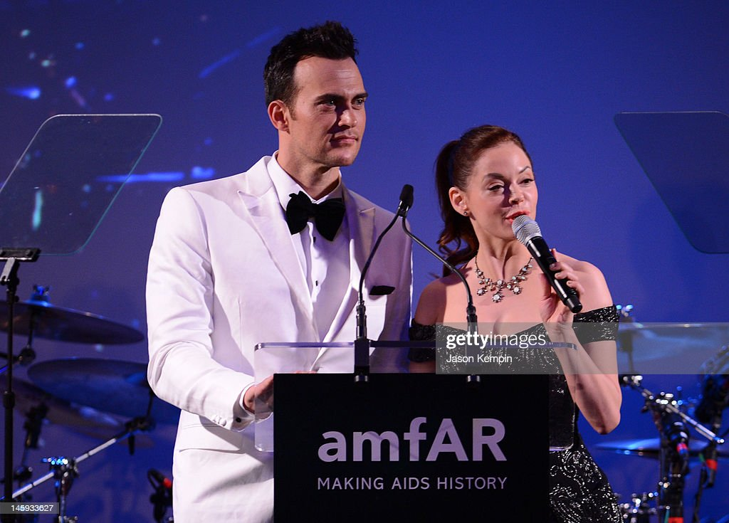 Cheyenne Jackson and Rose McGowan speak during the 3rd annual amfAR Inspiration Gala New York at The New York Public Library - Stephen A. Schwarzman Building on June 7, 2012 in New York City.