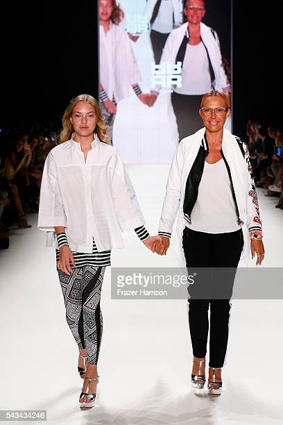 Cheyenne Ochsenknecht and her mother Natascha walk the runway at the Riani show during the MercedesBenz Fashion Week Berlin Spring/Summer 2017 at...