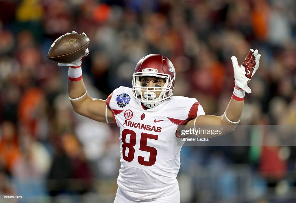 Cheyenne O'Grady #85 of the Arkansas Razorbacks reacts after catching a touchdown pass against the Virginia Tech Hokies during the Belk Bowl at Bank of America Stadium on December 29, 2016 in Charlotte, North Carolina.
