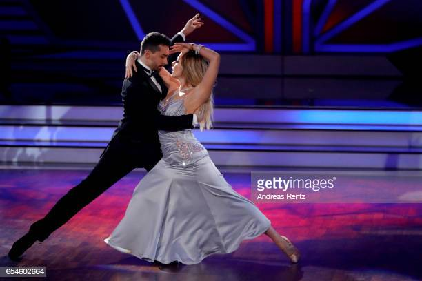 Cheyenne Pahde and Andrzej Cibis perform on stage during the 1st show of the tenth season of the television competition 'Let's Dance' on March 17...