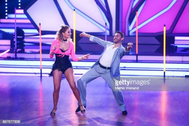 Cheyenne Pahde and Andrzej Cibis perform on stage during the 2nd show of the tenth season of the television competition 'Let's Dance' on March 24...