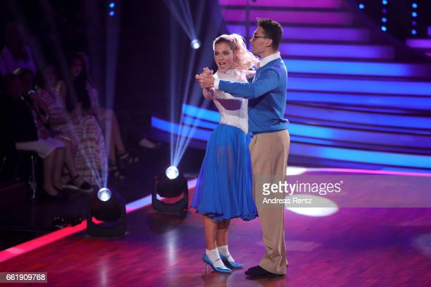Cheyenne Pahde and Andrzej Cibis perform on stage during the 3rd show of the tenth season of the television competition 'Let's Dance' on March 31...