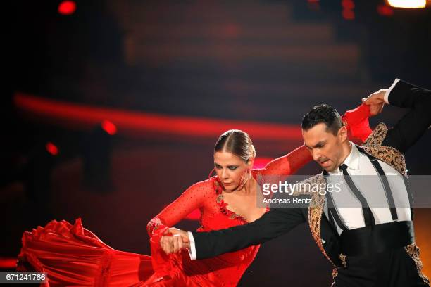 Cheyenne Pahde and Andrzej Cibis perform on stage during the 5th show of the tenth season of the television competition 'Let's Dance' on April 21...