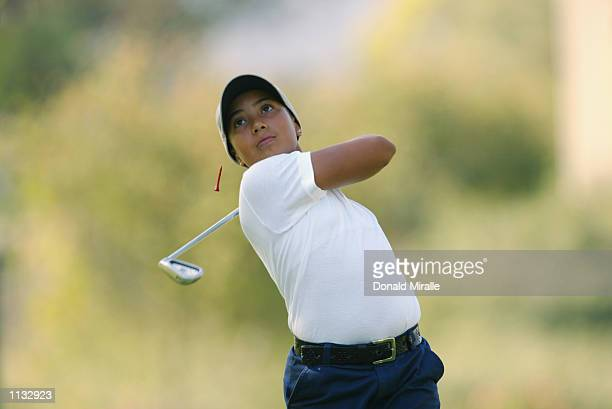Cheyenne Woods niece of Tiger Woods tees off the 8th hole during the 2nd Round of the Junior World Golf Championships on July 17 2002 at the Lawrence...