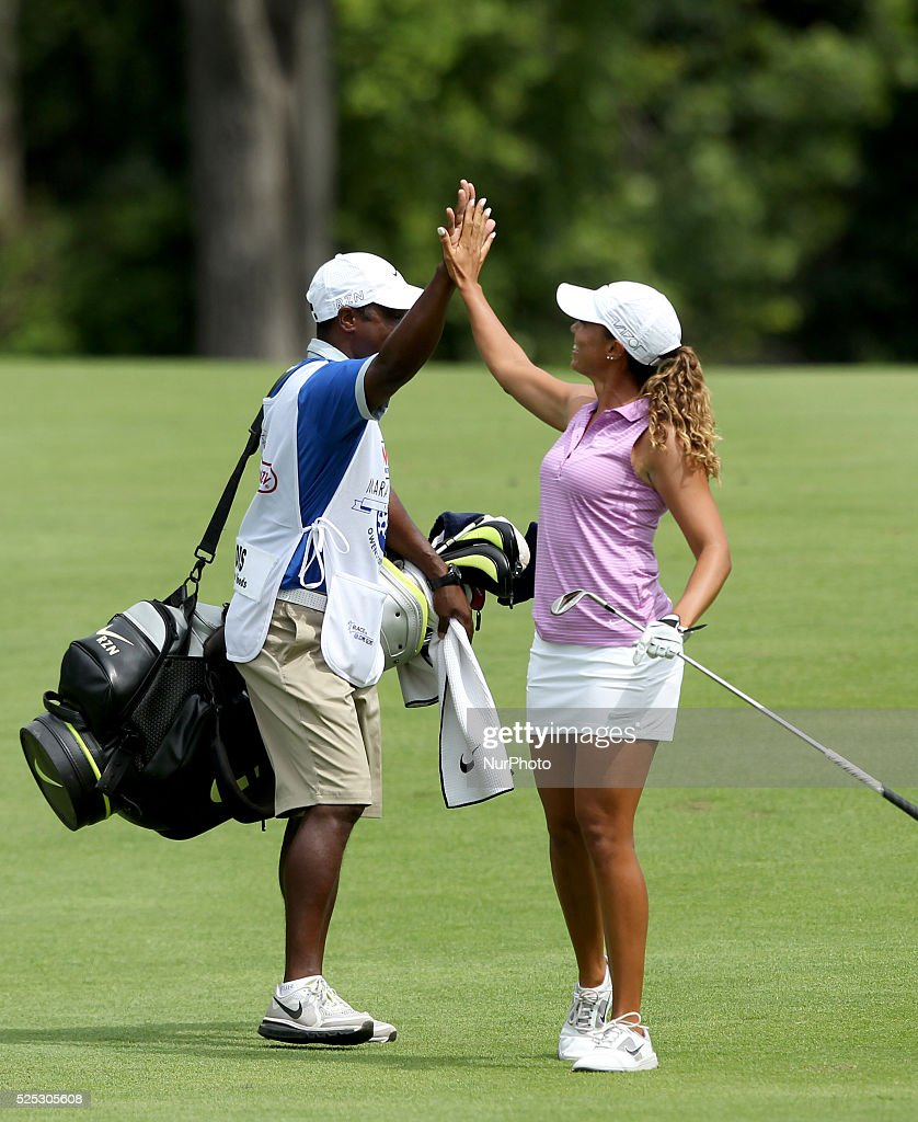 Cheyenne Woods of Phoenix AZ celebrates with caddie Reynolds Robinson after her bogey on the 18th hole during the first round of the Marathon LPGA...